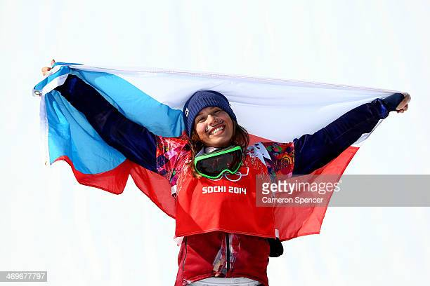 Gold medalist Eva Samkova of the Czech Republic celebrates during the flower ceremony for the Ladies' Snowboard Cross Finals on day nine of the Sochi...