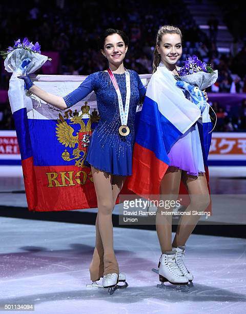 Gold medalist Evgenia Medvedeva of Russia and Bronze medalist Elena Radionova of Russia pose during the Ladies final medal ceremony during day three...