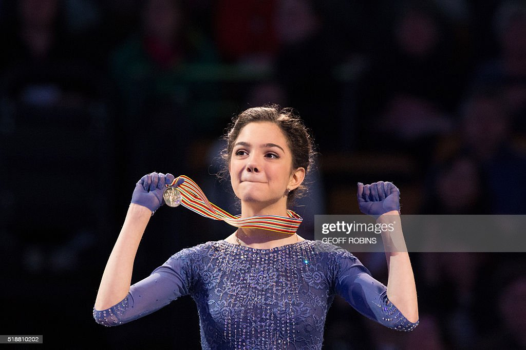 Gold medalist Evgenia Medvedeva of Russia celebrates during the victory ceremony for the Ladies competition at the ISU World Figure Skating Championships at TD Garden in Boston, Massachusetts, April 2, 2016. / AFP / Geoff Robins