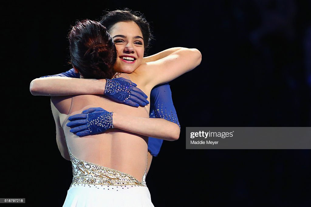 Gold medalist Evgenia Medvedeva of Russia, right, congratulates silver medalist Ashley Wagner of the United States on the podium following their perfomances in the Ladies Free Skate program on Day 6 of the ISU World Figure Skating Championships 2016 at TD Garden on April 2, 2016 in Boston, Massachusetts.