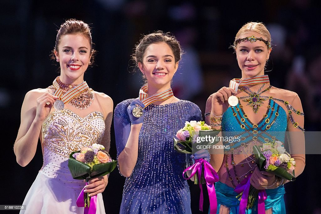 Gold medalist Evgenia Medvedeva of Russia sings the Russian National Anthem during the victory ceremony for the Ladies competition at the ISU World Figure Skating Championships at TD Garden in Boston, Massachusetts, April 2, 2016. / AFP / Geoff Robins