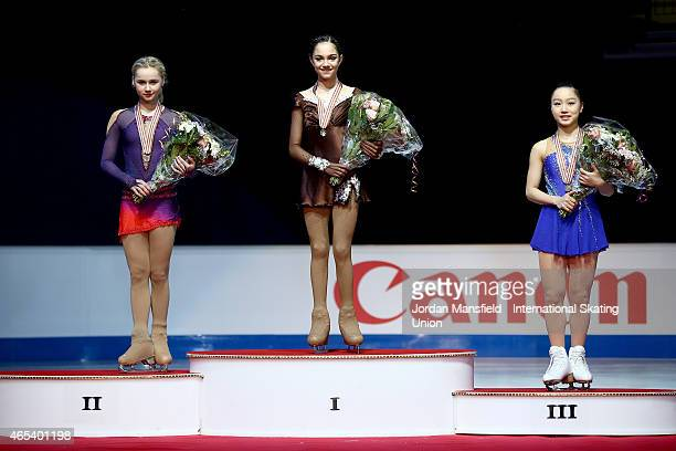 Gold medalist Evgenia Medvedeva Silver medalist Serafima Sakhanovich of Russia and Bronze medalist Wakaba Higuchi of Japan pose for a picture after...