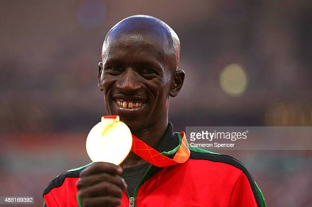 Gold medalist Ezekiel Kemboi of Kenya poses on the podium during the medal ceremony for the Men's 3000 metres steeplechase final during day four of...