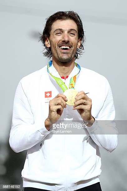 Gold medalist Fabian Cancellara of Switzerland celebrates on the podium at the medal ceremony for the Cycling Road Men's Individual Time Trial on Day...