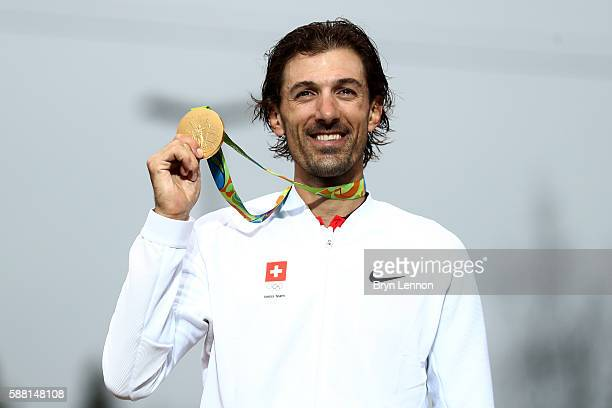 Gold medalist Fabian Cancellara of Switzerland poses for photographs with his medal on the podium at the medal ceremony for the Cycling Road Men's...