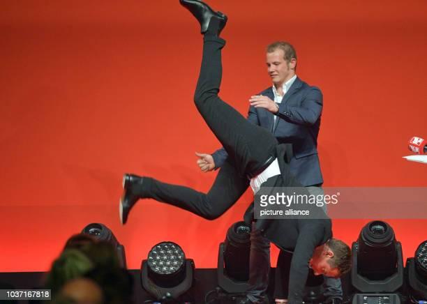 Gold medalist Fabian Hambuechen lets presenter Alexander Bommes show a handstand at the Sport BildAward ceremony in Hamburg Germany 29 august 2016...
