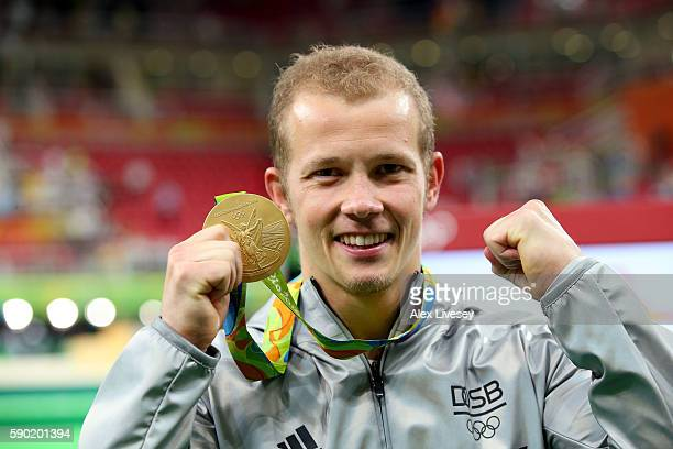 Gold medalist Fabian Hambuechen of Germany poses for photographs after the at the medal ceremony for the Horizontal Bar Final on Day 11 of the Rio...