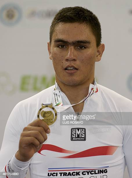 Gold medalist Fabian Puerta poses on the winner's podium of the UCI Cycling World Cup Men's Keirin at Alcides Nieto Patino velodrome on January 17 in...