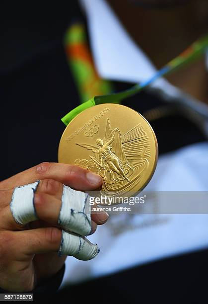 gold medalist Fabio Basile of Italy poses on the podium during the medal ceremony for the Men's 66kg Judo on Day 2 of the Rio 2016 Olympic Games at...