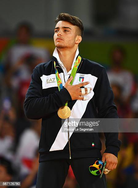 gold medalist Fabio Basile of Italy stands on the podium during the medal ceremony for the Men's 66kg Judo on Day 2 of the Rio 2016 Olympic Games at...