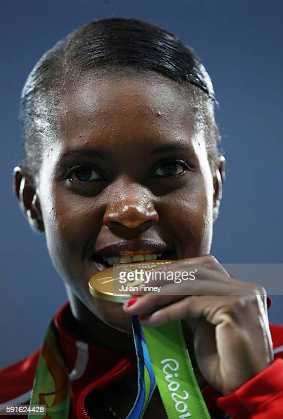 Gold medalist Faith Chepngetich Kipyegon of Kenya poses during the medal ceremony for the Women's 1500m Final on Day 12 of the Rio 2016 Olympic Games...
