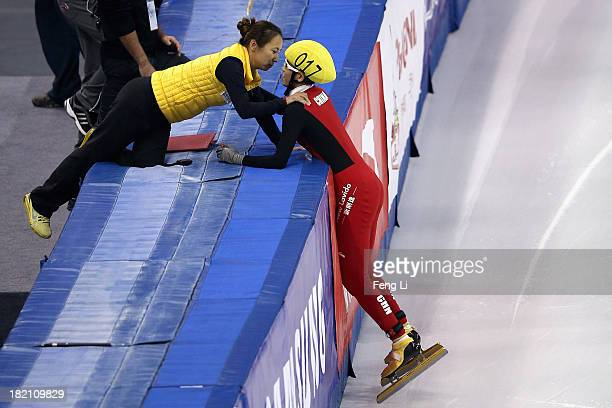Gold medalist Fan Kexin celebrates with her coach after winning the Women's 500m Final during day three of the Samsung ISU World Cup Short Track at...