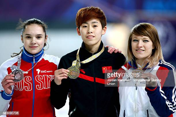 Gold medalist Fan Kexin of China silver medalist Sofia Prosvirnova of Russia and bronze medalist Elise Christie of Great Britain pose for a picture...