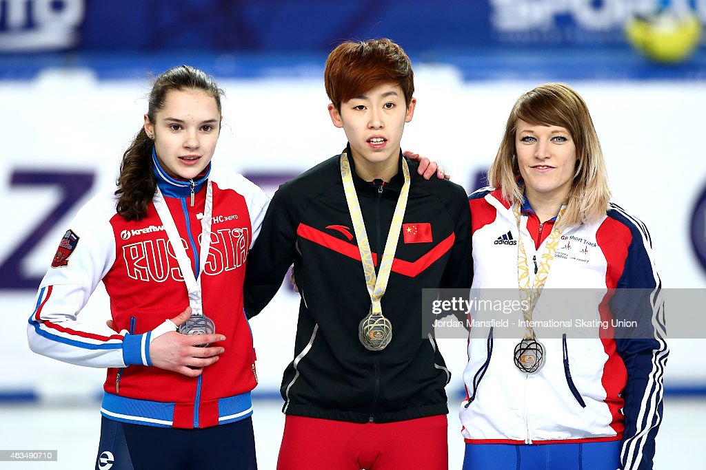 Gold medalist Fan Kexin of China (C), Silver medalist Sofia Prosvirnova of Russia (L) and Elise Christie of Great Britain (R) pose for a picture with their medals the Women's 500m Final on day two of the ISU World Cup Short Track Speed Skating on February 15, 2015 in Erzurum, Turkey.