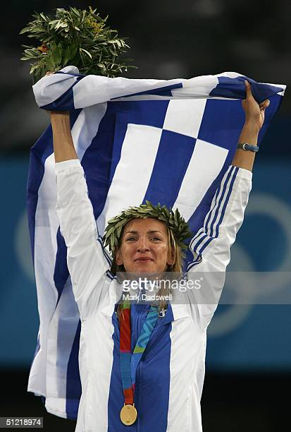 Gold medalist Fani Halkia of Greece celebrates on the podium during the medal ceremony of the women's 400 metre hurdle event on August 25 2004 during...