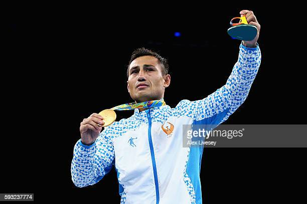 Gold medalist Fazliddin Gaibnazarov of Uzbekistan poses on the podium during the medal ceremony for the Men's Boxing Light Welter on Day 16 of the...