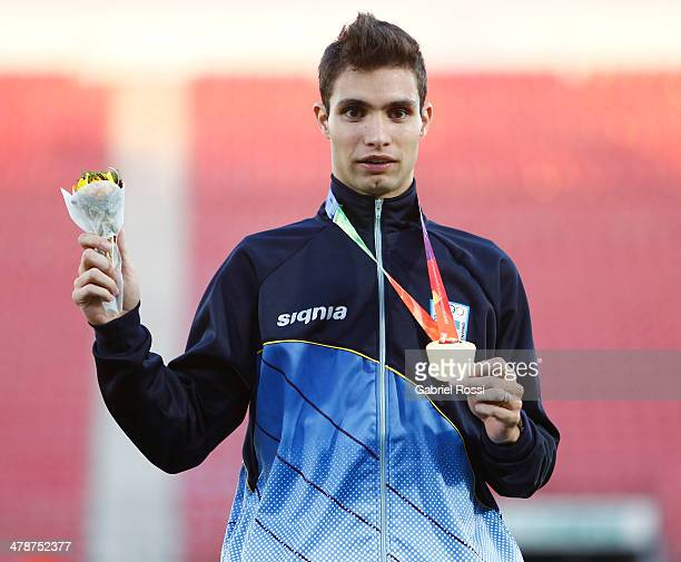 Gold medalist Federico Bruno of Argentina in the podium of Men's 1,500m during day eight of the X South American Games Santiago 2014 at Estadio...