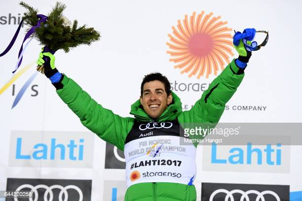 Gold medalist Federico Pellegrino of Italy celebrates following the Men's 16KM Cross Country Sprint final during the FIS Nordic World Ski...