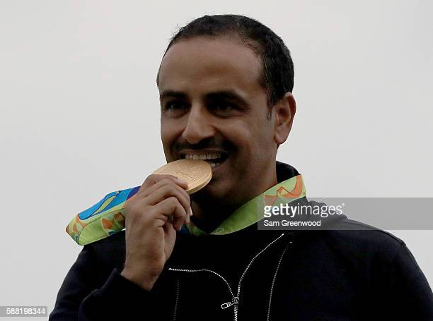 Gold medalist Fehaid Aldeehani poses on the podium following the Double Trap event on Day 5 of the Rio 2016 Olympic Games at the Olympic Shooting...