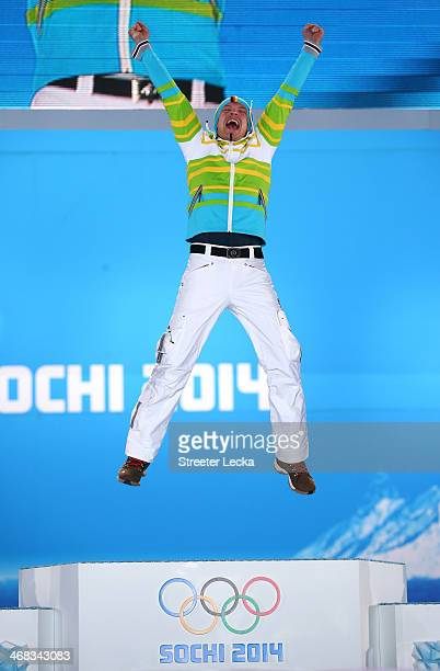 Gold medalist Felix Loch of Germany celebrates during the medal ceremony for the Men's Luge Singles on day 3 of the Sochi 2014 Winter Olympics at...