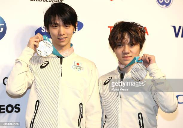 Gold Medalist Figure Skater Yuzuru Hanyu of Japan and Silver Medalist Figure Skater Shoma Uno of Japan pose with their medals during a press...