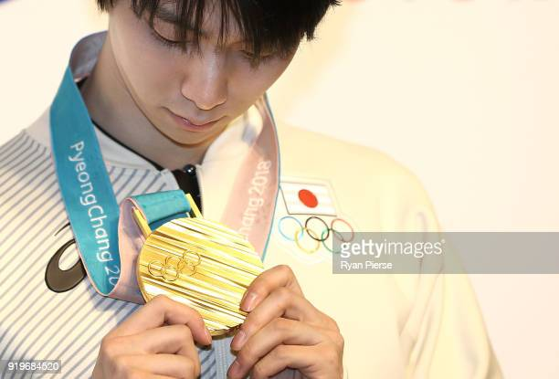 Gold Medalist Figure Skater Yuzuru Hanyu poses with his medal during a press conference at Japan House on February 18, 2018 in Pyeongchang-gun, South...