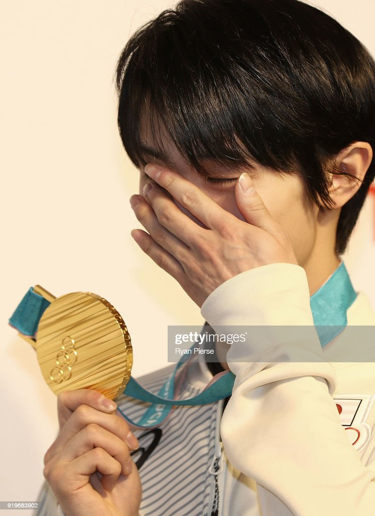 Gold Medalist Figure Skater Yuzuru Hanyu reacts while posing with his medal during a press conference at Japan House on February 18, 2018 in Pyeongchang-gun, South Korea.
