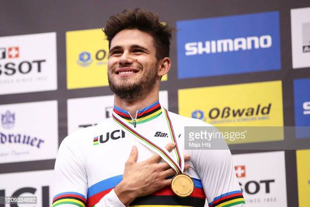 Gold medalist Filippo Ganna of Italy poses on the podium after the men's individual pursuit final during day 3 of the UCI Track Cycling World...