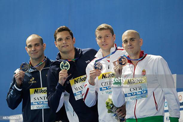 Gold medalist Florent Manaudou of France poses with silver medalist Nicholas Santos of Brazil and bronze medalists Laszio Cseh of Hungary and Konrad...