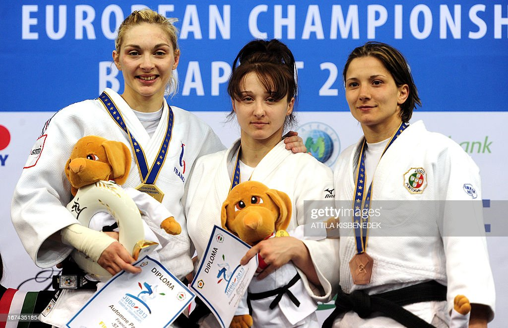 Gold medalist France's Automne Pavia (L) cebrates on the podium with bronze medalists, Portugal's Telma Monteiro (R) and Russia's Irina Zabludina (C) after her victory over Austria's Sabrina Filzmoser (not pictured) after their final of the Judo European Championships in 57kg category for women in Budapest.