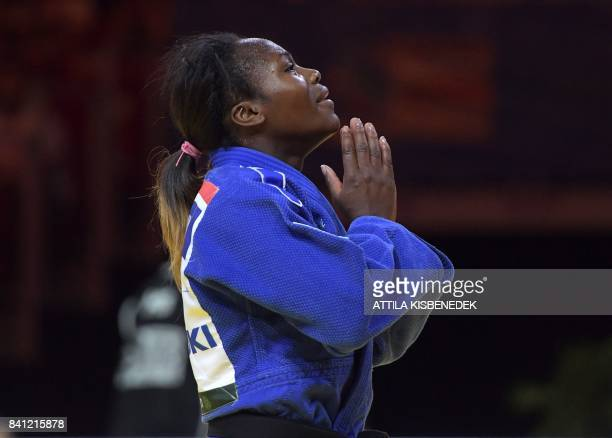 Gold medalist France's Clarisse Agbegnenou celebrates her victory against Slovenia's Tina Trstenjak during their final match in the womens 63kg...