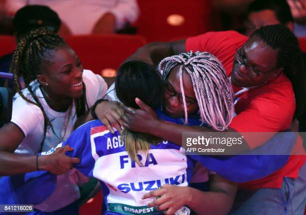 Gold medalist France's Clarisse Agbegnenou celebrates her victory against Slovenia's Tina Trstenjak after their final match in the womens 63kg...