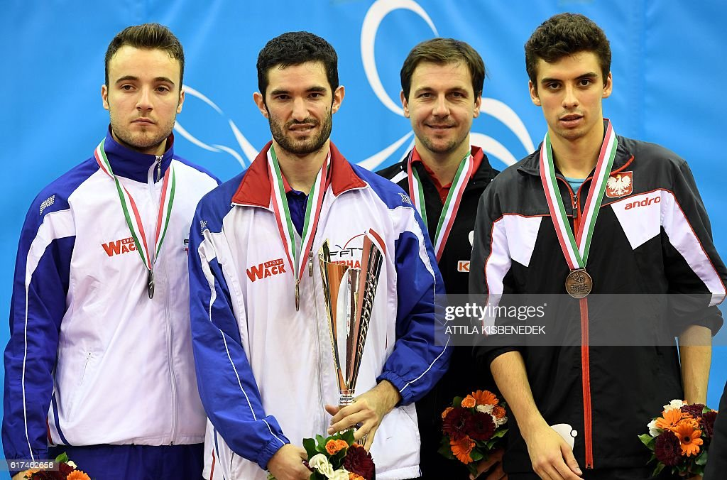 Gold medalist France's Emmanuel Lebesson (2nd L) poses on the podium with silver medalist France's Simon Gauzy (L), bronze medalists Germany's Timo Boll (2nd R) and Poland's Jakub Dyjas (R) in 'Tuskecsarnok' sports hall of Budapest on October 23, 2016 during the medal ceremony of LIEBHER 2016 ITTF European Table Tennis Championships. / AFP / ATTILA
