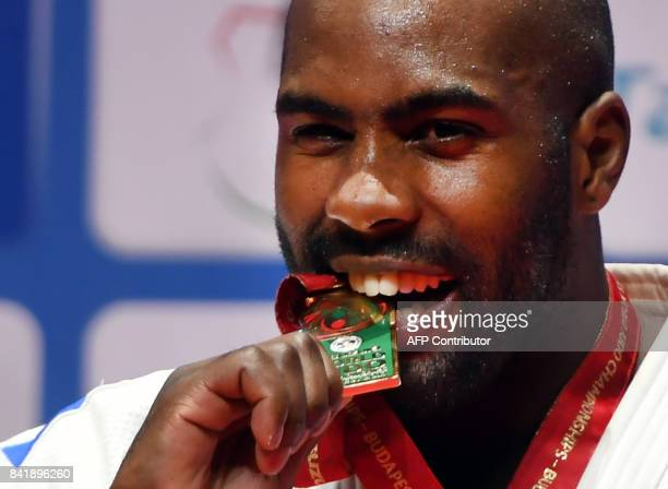 Gold medalist France's Teddy Riner celebrates on the podium of the mens 100kg category at the Judo World Championships in Budapest on September 1...