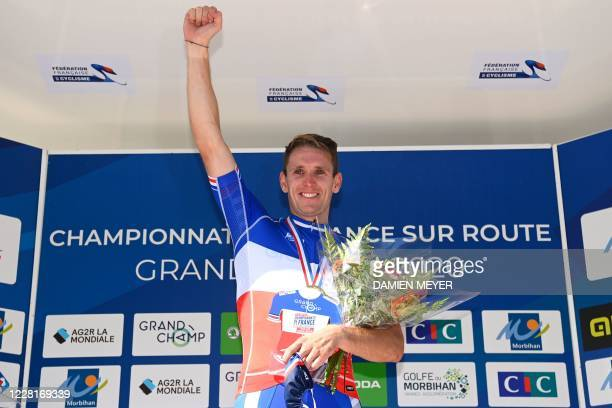 Gold medalist French Arnaud Demare celebrates during the podium ceremony after winning the French Elite men road cycling championship in Grand Champ,...