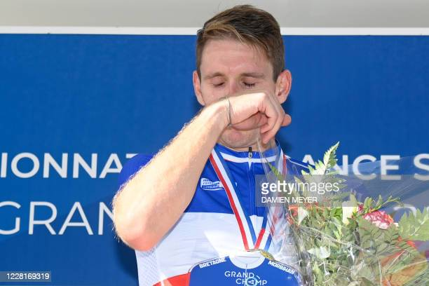 Gold medalist French Arnaud Demare reacts during the podium ceremony after winning the French Elite men road cycling championship in Grand Champ,...