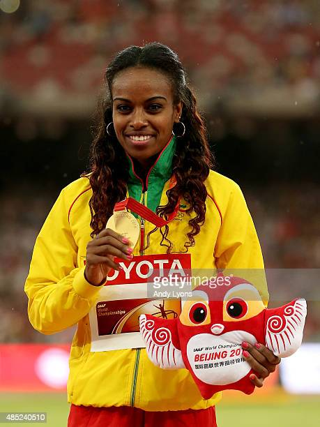 Gold medalist Genzebe Dibaba of Ethiopia poses on the podium during the medal ceremony for the Women's 1500 metres final during day five of the 15th...