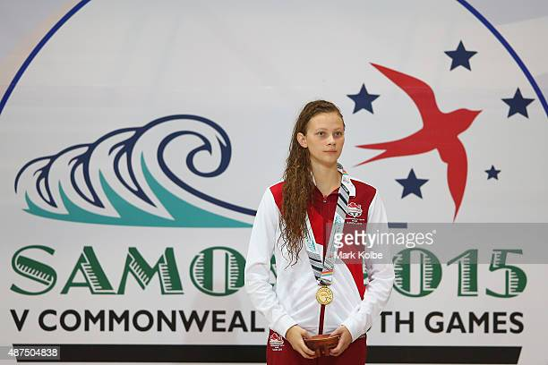 Gold medalist Georgia Darwent of England watches on during the medal ceremony for the girls 800m freestyle final at the aquatic centre of the...