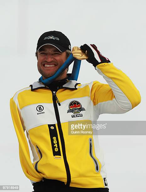 Gold medalist Gerd Schonfelder of Germany celebrates at the medal ceremony for the Men's Standing Super Combined during Day 9 of the 2010 Vancouver...