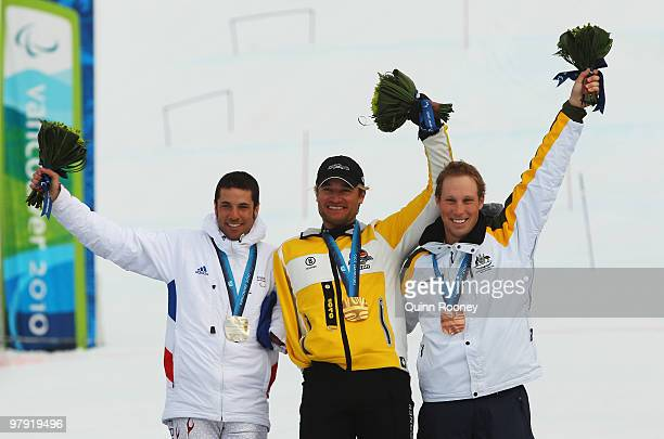 Gold medalist Gerd Schonfelder of Germany celebrates with silver medalist Vincent GauthierManuel of France and bronze medalist Cameron RahlesRahbula...