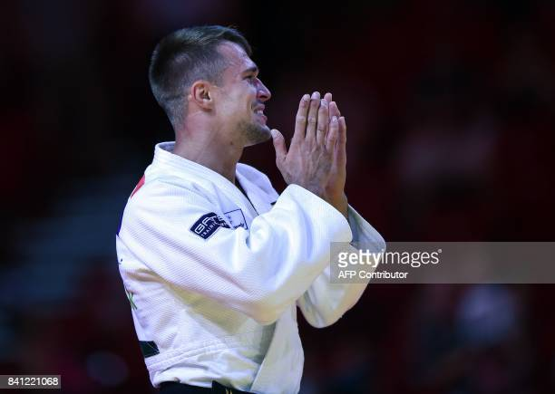 Gold medalist Germany's Alexander Wieczerzak celebrates his victory over Italy's Matteo Marconcini after their final in the mens 81kg category at the...