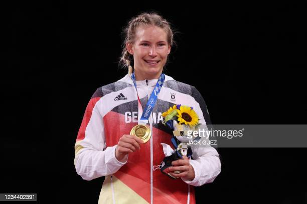 Gold medalist Germany's Aline Rotter Focken poses on the podium after the women's freestyle 76kg wrestling competition of the Tokyo 2020 Olympic...
