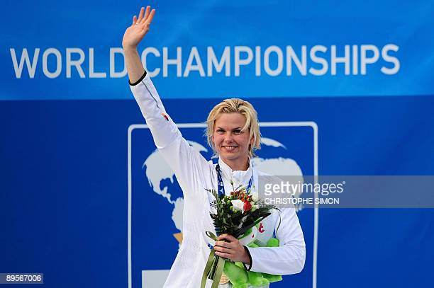 Gold medalist Germany's Britta Steffen celebrates on the podium of the women's 50m freestyle on August 2 2009 at the FINA World Swimming...