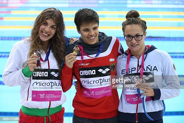 Gold medalist Germany's Franziska Hentke poses for a photograph with silver medalist Hungary's Liliana Szilagyi and bronze medalist Judit Ignacio...