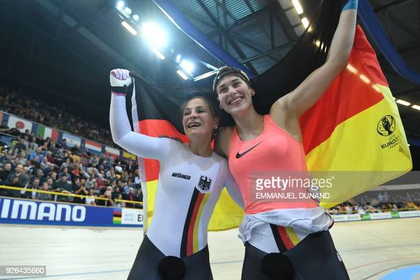 Gold medalist Germany's Kristina Vogel and Bronze medalist Germany's Pauline Sophie Grabosch celebrate after women's sprint final during the UCI...