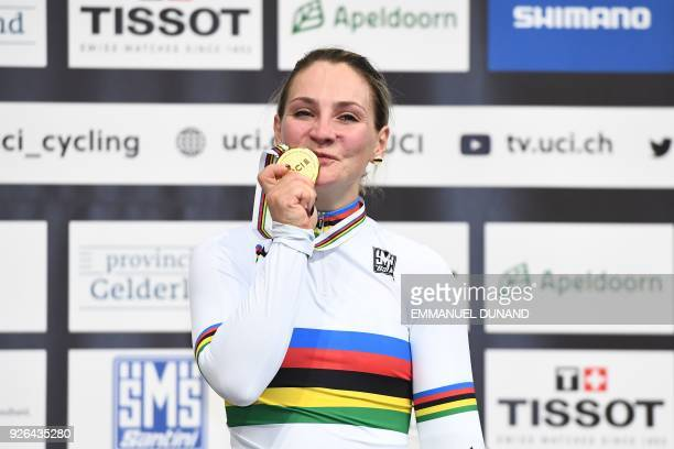 Gold medalist Germany's Kristina Vogel celebrates on the podium after taking part in the women's sprint final during the UCI Track Cycling World...