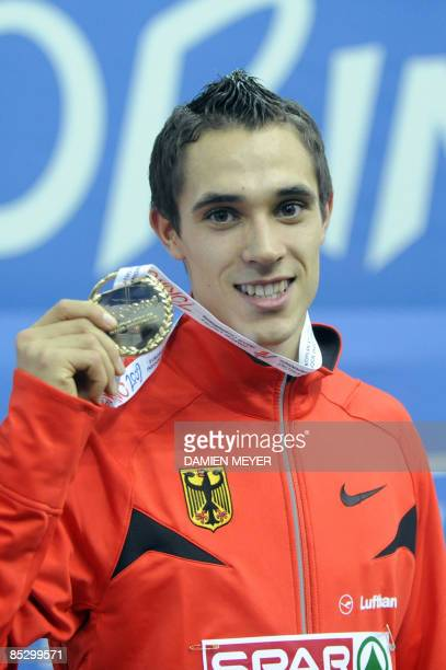 Gold medalist Germany's Sebastian Bayer celebrates on the Men's Long Jump podium of the European Athletics Indoor Championships on March 8 2009 in...