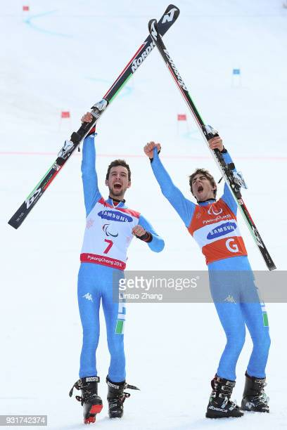 Gold Medalist Giacomo Bertagnolli and his guide Fabrizio Casal of Italy celebrates at the victory ceremony for Men's Giant Slalom Visually Impaired...