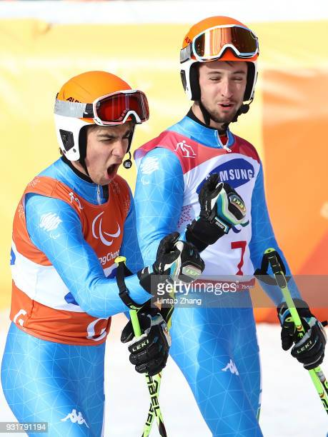 Gold Medalist Giacomo Bertagnolli and his guide Fabrizio Casal of Italy celebrates after competes in Men's Giant Slalom Visually Impaired at Alpensia...