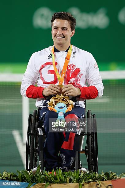 Gold medalist Gordon Reid of Great Britain celebrates on the podium at the medal ceremony for the Men's Singles Wheelchair Tennis during day 9 of the...